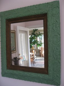 Antique mirror frame with leaf detail